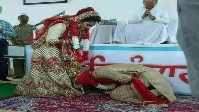 GROOM TOUCHES FEET OF BRIDE